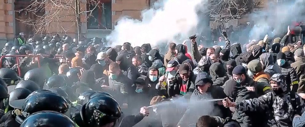In this image from video provided by the Radio Free Europe/Radio Liberty, far-right demonstrators clash with riot police outside the presidential administration building in Kiev, Ukraine, Saturday, March 9, 2012. Three police officers in Ukraine have