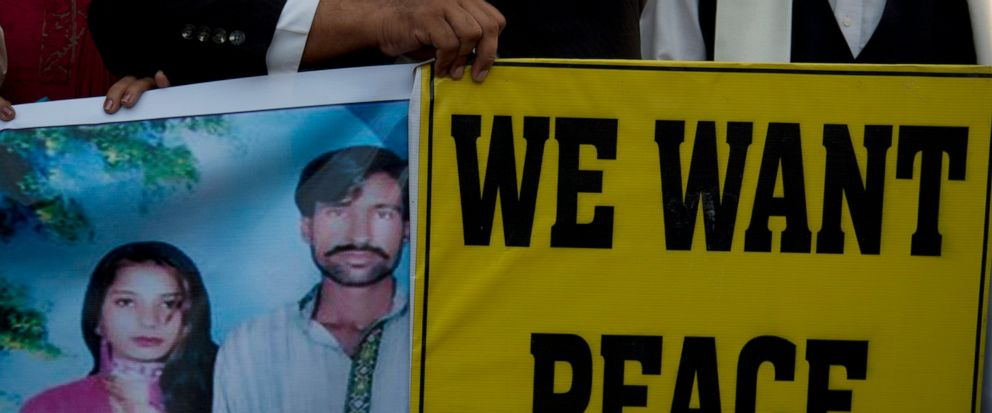 FILE - In this Nov. 7, 2014 file photo Pakistani human rights activists hold a picture of a Christian couple during a demonstration in Karachi, Pakistan. A Pakistani court on Thursday, May 16, 2019 upheld death sentences for three Muslims but acquitt