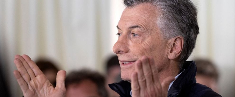 "Argentinas President Mauricio Macri reacts as he talks to journalists after casting his vote during primary elections in Buenos Aires, Argentina, Sunday, Aug. 11, 2019. Macri is running for re-election with the ""Juntos por el Cambio"" party, in the S"