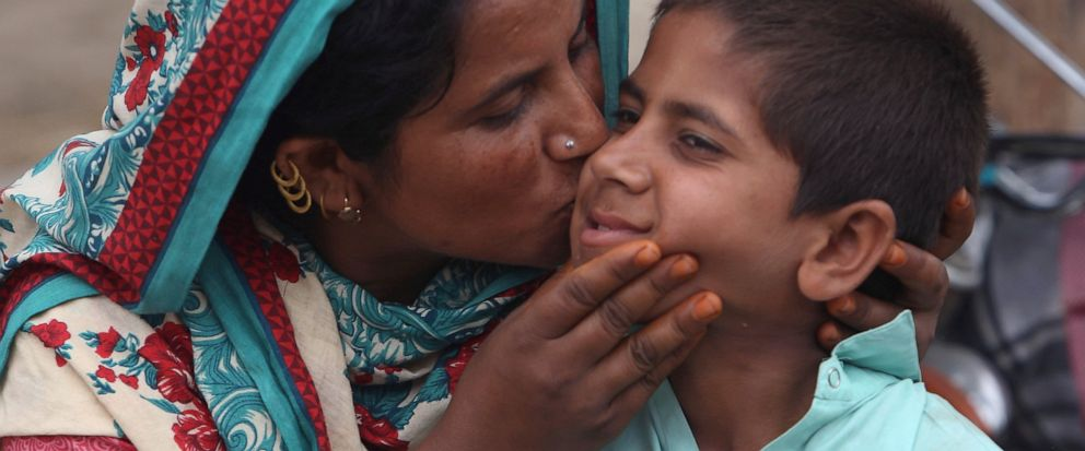 A Pakistani mother kisses her son Ali Raza, 10, infected with HIV in a village near Ratodero, a small town in southern province of Sindh in Pakistan, Thursday, May 16, 2019. Officials say about 500 people, mostly children, have tested positive for HI