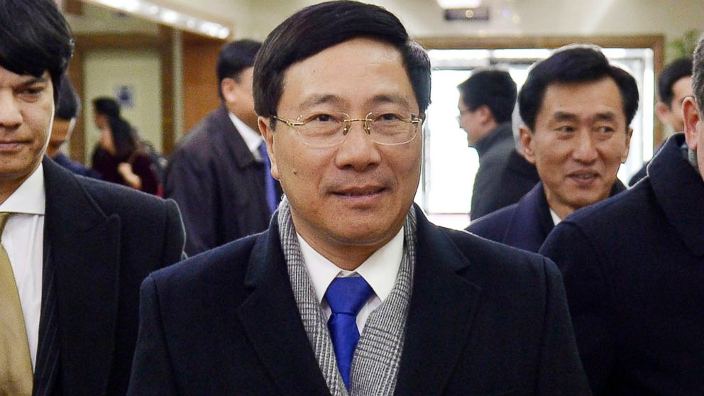 Vietnamese Foreign Minister Pham Binh Minh arrives at Pyongyang International Airport in Pyongyang, North Korea, Tuesday, Feb. 12, 2019. Pham visited Pyongyang for meetings ahead of the next summit between U.S. President Donald Trump and North Korean leader Kim Jong Un scheduled for Feb. 27-28. (Kyodo News via AP)