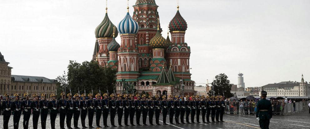 FILE - In this June 30, 2018, file photo, Kremlin guards perform in Red Square with the with St. Basils Cathedral in the background, in Moscow, Russia. A negotiating team from the Taliban arrived Friday, Setp. 13, 2019, in Russia, a representative s