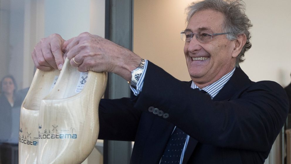 In a sign of the looming Brexit, Italy's Guido Rasi, director of the European Medicines Agency holds a pair of wooden shoes he was presented by Dutch Health Minster Bruno Bruins during the official opening of the agency's temporary headquarters in Amsterdam, Netherlands, Wednesday, Jan. 9, 2019. The London-based agency is moving to the Dutch capital after Brexit and is scheduled to move to the permanent location at Zuidas, Amsterdam's business district, later this year. (AP Photo/Peter Dejong)