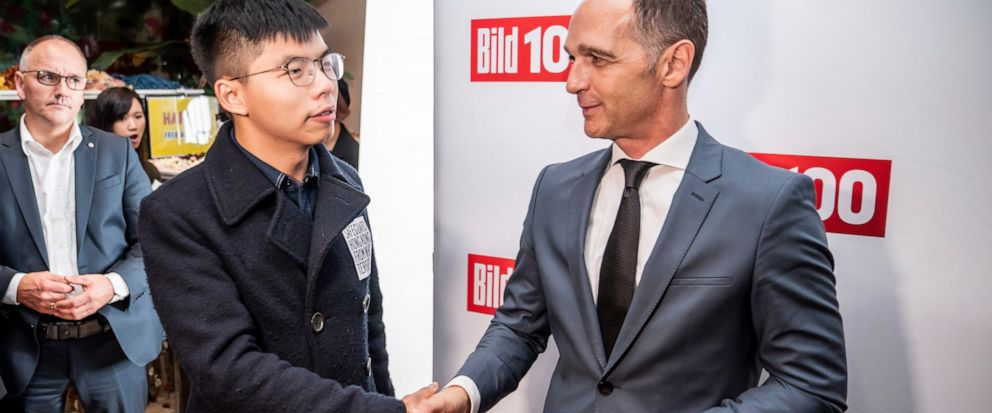 German Foreign Minister Heiko Maas, right, and Hong Kong activist Joshua Wong, left, shake hands during a reception of a German news paper in Berlin, Germany, Monday, Sept. 9, 2019. Wong will address the media during a press conference in Berlin on W