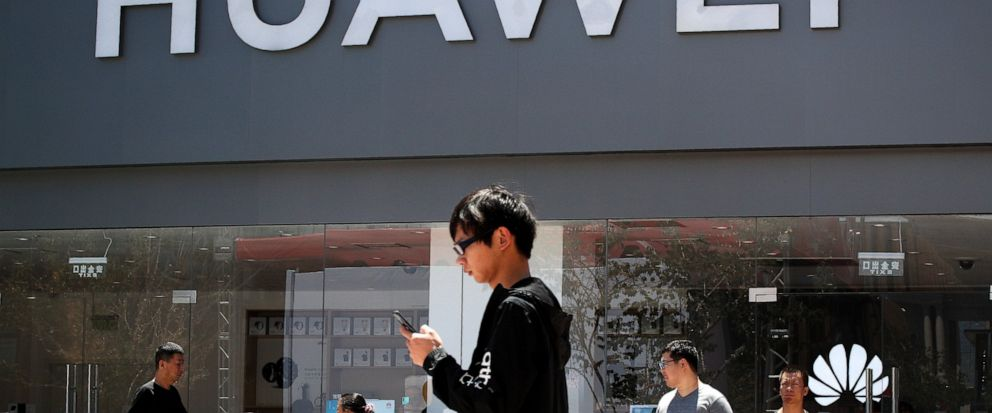 People walk past a Huawei retail store in Beijing, Sunday, June 30, 2019. Once again, Presidents Donald Trump and Xi Jinping have hit the reset button in trade talks between the worlds two biggest economies, at least delaying an escalation in tensio