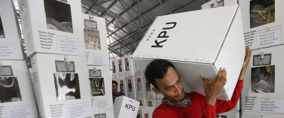 Workers carry ballot boxes to be distributed to polling stations in Jakarta, Indonesia, Tuesday, April 16, 2019. Nearly 193 million Indonesians are eligible to vote in presidential and legislative elections on Wednesday. President Joko Widodo, the fi