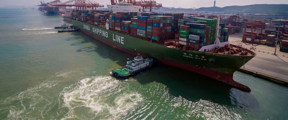 In this Aug. 6, 2019, photo, tugboats manuever a container ship at a port in Qingdao in eastern Chinas Shandong province. Chinese imports of American goods plunged in July as a tariff war with Washington intensified. (Chinatopix via AP)