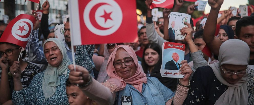 Supporters of independent Tunisian Presidential candidate Kais Saied attend a rally on the last day of campaigning before the second round of the presidential elections, in Tunis, Tunisia, Friday, Oct. 11, 2019. (AP Photo/Mosaab Elshamy)