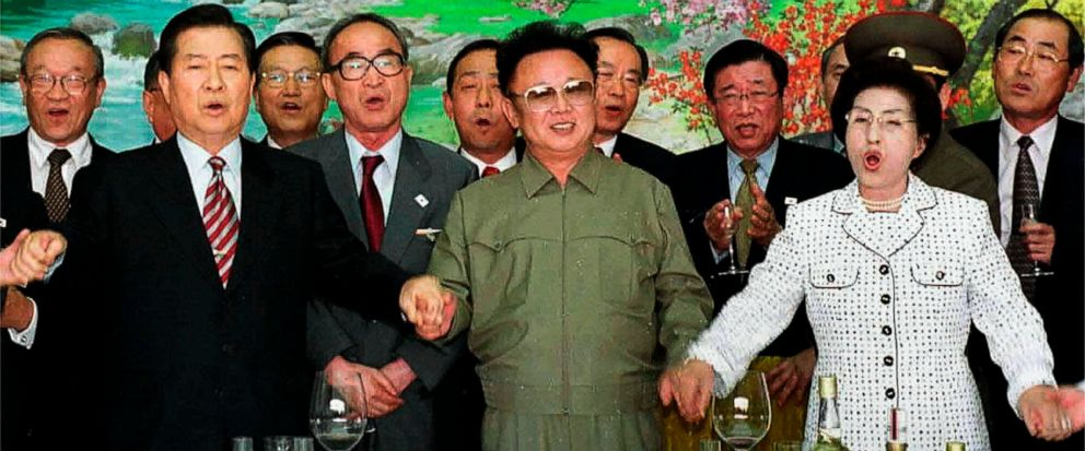 "FILE - In this June 15, 2000, file photo, from left in front row; former South Korean President Kim Dae-jung, former North Korean leader Kim Jong Il, and former South Korean First Lady Lee Hee-ho, hold hands as they sing a song titled ""We Are Hoping"