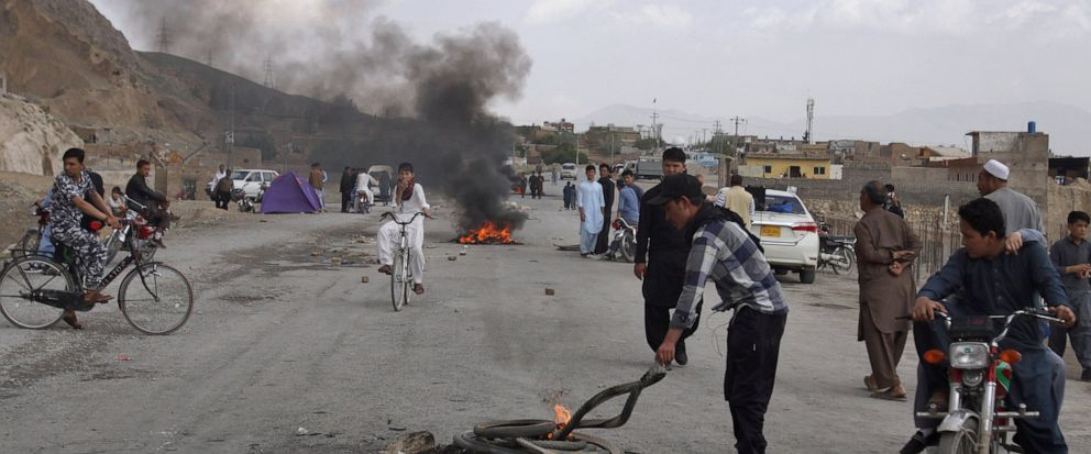 Pakistani Shiite youth from Hazara community burn tires to block a main road during a protest to condemn Fridays suicide bombing, in Quetta, Pakistan, Saturday, April 13, 2019. A suicide bomber targeted an open-air market in the southwestern Pakista