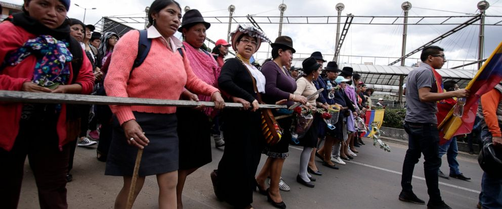 Indigenous anti-government demonstrators march against President Lenin Moreno and his economic policies during a nationwide strike, in Quito, Ecuador, Wednesday, Oct. 9, 2019. Ecuadors military has warned people who plan to participate in a national