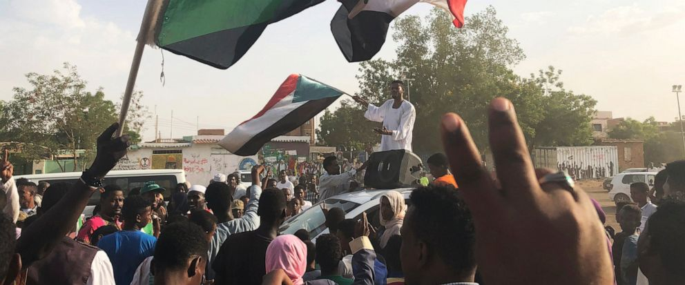 Sudanese people celebrate in the streets of Khartoum after ruling generals and protest leaders announced they have reached an agreement on the disputed issue of a new governing body on Friday, July 5, 2019. The deal raised hopes it will end a three-m