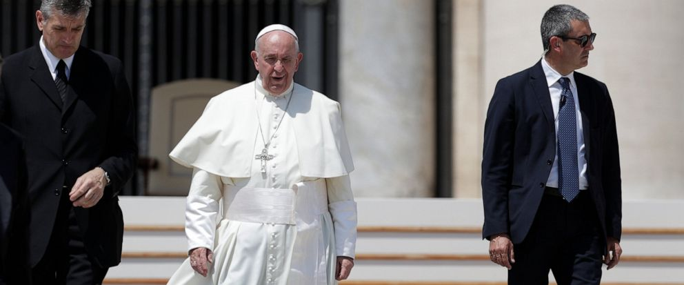 Pope Francis leaves at the end of his weekly general audience in St. Peter square at the Vatican, Wednesday, June 5, 2019. At left is Francis butler Sandro Mariotti. (AP Photo/Andrew Medichini)