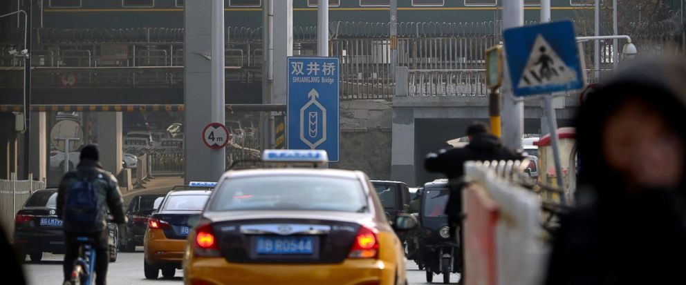 A train similar to ones seen during previous visits by North Korean leader Kim Jong Un passes along a railroad overpass as it heads away from Beijing Railway Station in Beijing, Wednesday, Jan. 9, 2019. North Korean leader Kim Jong Uns train was see