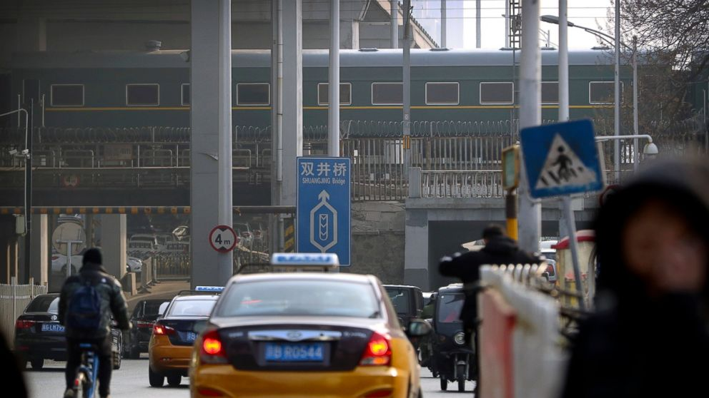 A train similar to ones seen during previous visits by North Korean leader Kim Jong Un passes along a railroad overpass as it heads away from Beijing Railway Station in Beijing, Wednesday, Jan. 9, 2019. North Korean leader Kim Jong Un's train was seen leaving Beijing on Wednesday after a two-day visit to the Chinese capital. (AP Photo/Mark Schiefelbein)