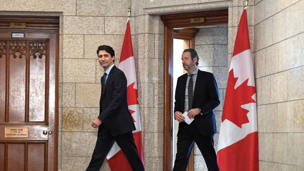 In this April 10, 2018, photo, Canadian Prime Minister Justin Trudeau leaves his office with his principal secretary Gerald Butts to attend an emergency cabinet meeting on Parliament Hill in Ottawa, Ontario. Trudeau's top adviser Butts resigned Monday, Feb. 18, 2019, while denying allegations that he pressured Canada's former attorney general to avoid prosecuting a major Canadian engineering company. (Justin Tang/The Canadian Press via AP)
