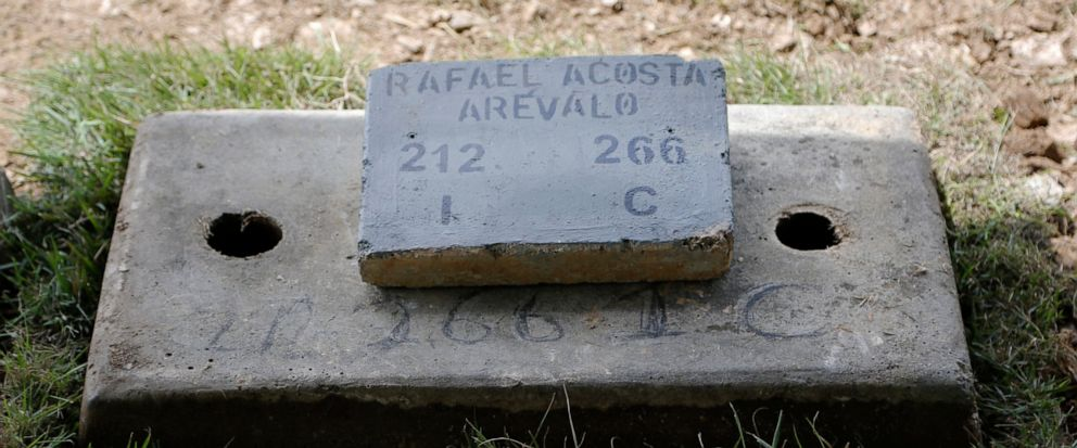 The tomb of Navy Captain Rafael Acosta lies at the East cemetery in Caracas, Venezuela, Wednesday July 10, 2019. Acosta, a Venezuelan navy captain who died of suspected torture while in government custody, was buried by authorities against the family