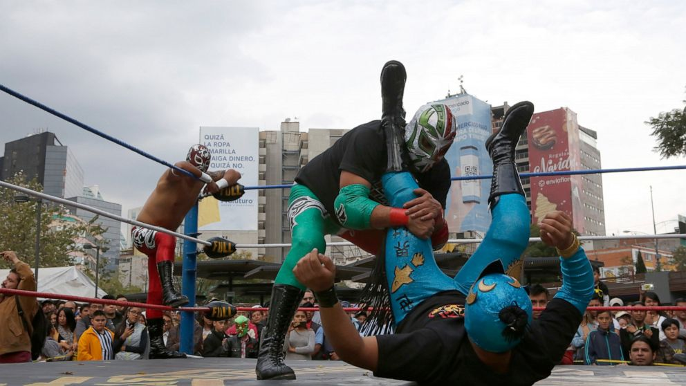 Mexican wrestlers thrill public at historic Metro station thumbnail