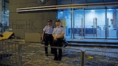 Riot police stand guard at a entrance after they clear barricades blocked by protesters outside the police headquarters as thousands gathered to demand for an independent inquiry into a heavy-handed police crackdown at a protest earlier this month, i