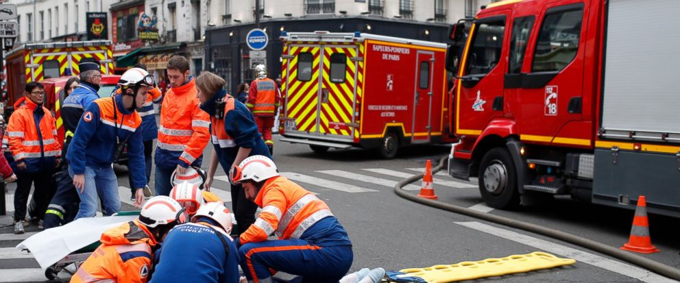 Firefighters tends to a wounded person near the site of a gas leak explosion in Paris, France, Saturday, Jan. 12, 2019. A powerful explosion and fire apparently caused by a gas leak at a Paris bakery Saturday injured several people, blasted out windo