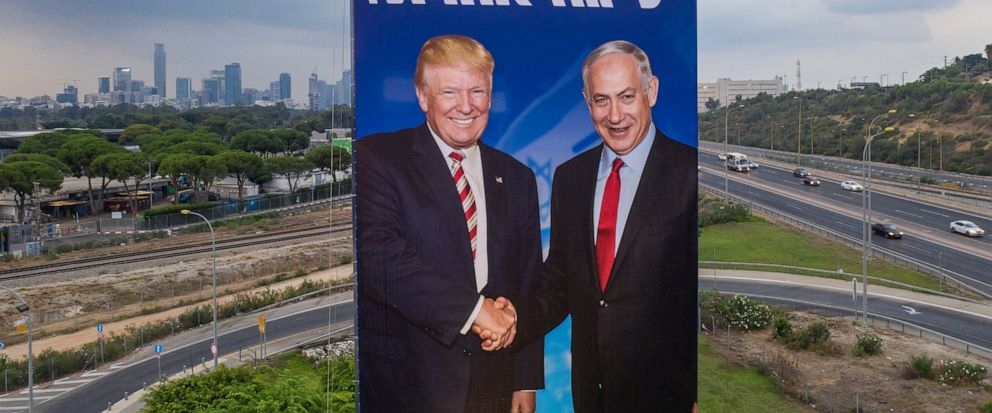 """A worker hangs an election campaign billboard of the Likud party shows Israeli Prime Minister Benjamin Netanyahu, right, and US President Donald Trump in Tel Aviv, Israel, Sunday, Sept 8, 2019. Hebrew on billboard reads """"Netanyahu, in another league"""""""