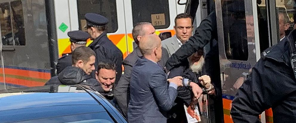 Police bundle WikiLeaks founder Julian Assange from the Ecuadorian embassy into a police van in London after he was arrested by officers from the Metropolitan Police and taken into custody Thursday April 11, 2019. Police in London arrested WikiLeaks