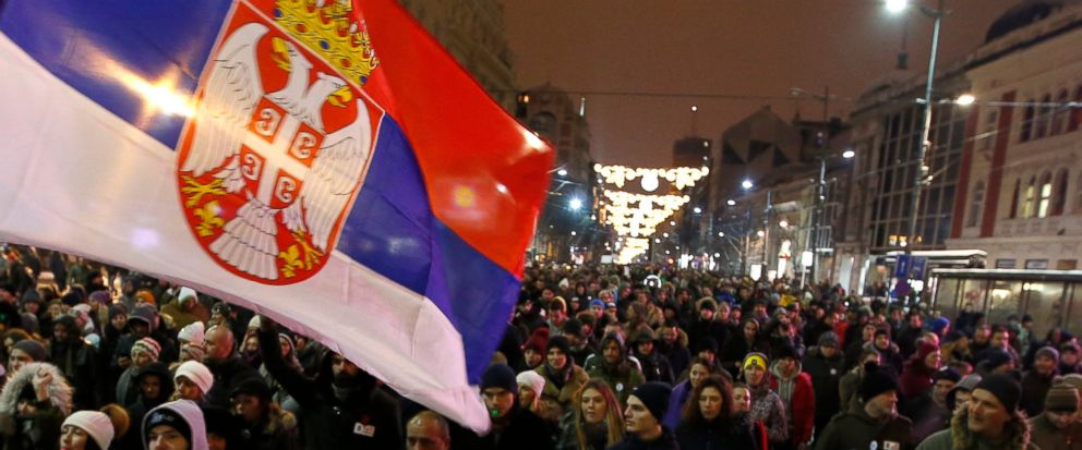 People march during a protest against populist President Aleksandar Vucic in Belgrade, Serbia, Saturday, Jan. 12, 2019. Critics accuse the president of imposing an autocracy through strict control over the media and promoting hate speech against the