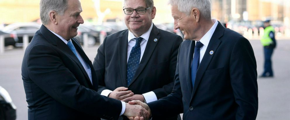 Foreign Minister of Finland Timo Soini, center, and Secretary General of the Council of Europe Thorbjrn Jagland, right, welcome Finlands President Sauli Niinist to the Commemoration Ceremony of the 70th anniversary of the Council of Europe in Hels