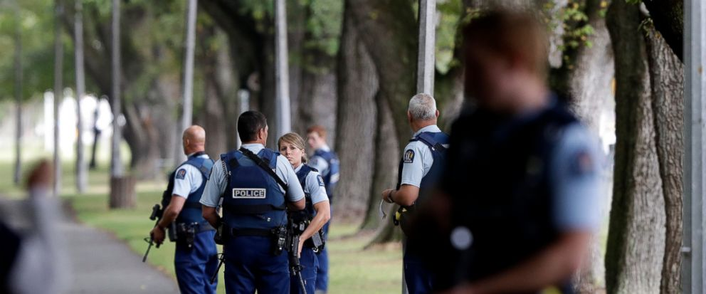Police keep watch at a park across the road from a a mosque in central Christchurch, New Zealand, Friday, March 15, 2019. Multiple people were killed in mass shootings at two mosques full of people attending Friday prayers, as New Zealand police warn