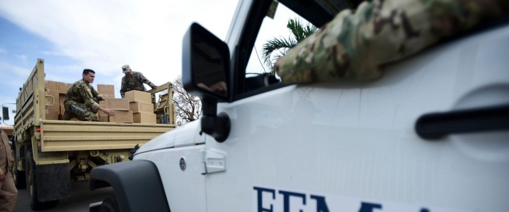 FILE - In this Oct. 5, 2017 file photo, Department of Homeland Security personnel deliver supplies to Santa Ana community residents in the aftermath of Hurricane Maria in Guayama, Puerto Rico. Federal authorities said Tuesday, Sept. 10, 2019, that th