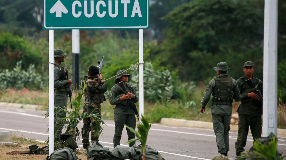Venezuelan Bolivarian Army soldiers stand guard at the Tienditas International Bridge that links Colombia and Venezuela, near Urena, Venezuela, Friday, Feb. 8, 2019. As humanitarian aid kits were being packed into individual white bags in the city of Cucuta, just across the river from Venezuela, U.S. officials and Venezuelan opposition leaders appealed to the military to the let the aid through. (AP Photo/Fernando Llano)