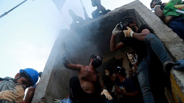 Masked gunmen attack protesters in Iraq holy city; 18 killed