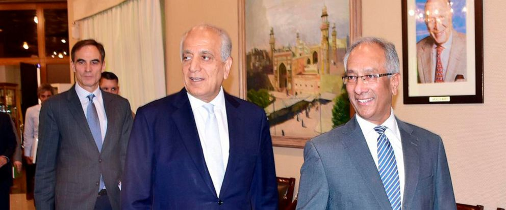 In this photo released by the Foreign Office, Pakistans Foreign Ministry official Aftab Khokhar, right, escorts visiting Special Representative for Afghanistan Reconciliation Zalmay Khalilzad, center, for talks at the Foreign Office in Islamabad, Pa