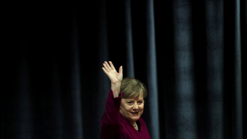 German Chancellor Angela Merkel waves the students during her visit in a German school in Athens, Friday, Jan. 11, 2019. Merkel is widely blamed in Greece for the austerity that the country has lived through for much of the past decade, which led to a sharp and prolonged recession and a consequent fall in living standards. (AP Photo/Petros Giannakouris)
