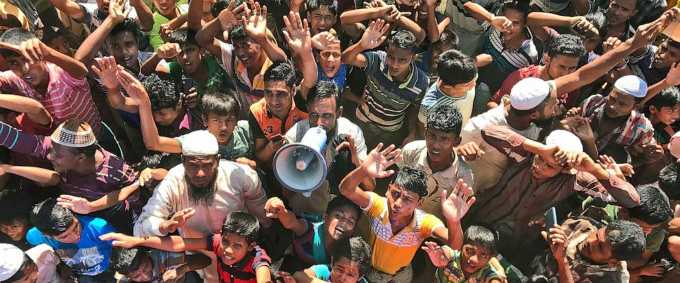 FILE - In this Nov. 15, 2018, file photo, Rohingya refugees shout slogans against repatriation at Unchiprang camp near Coxs Bazar, in Bangladesh. Myanmar and Bangladesh are making a second attempt to start repatriating Rohingya Muslims after more th