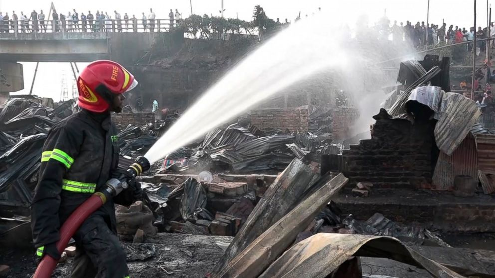 Firefighters damp down the area following a deadly fire in a poor residential area of the seaport city Chattogram, southern Bangladesh, Sunday Feb. 17, 2019. At least eight people are feared dead after a fire engulfed the residential area, razing some 200 closely packed houses to the ground, fire service said Sunday. (AP Photo)