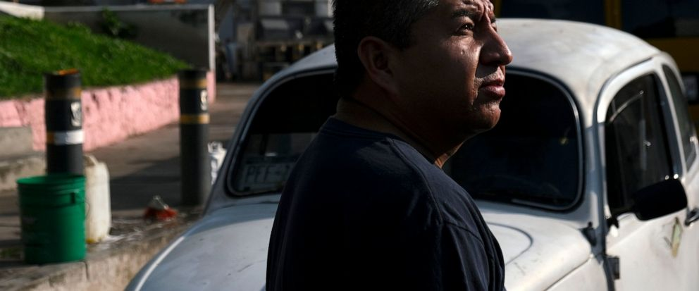 5742412e0a Mechanic Bernardo Garcia stands in front of his Volkswagen Beetle in a  neighborhood of Mexico City