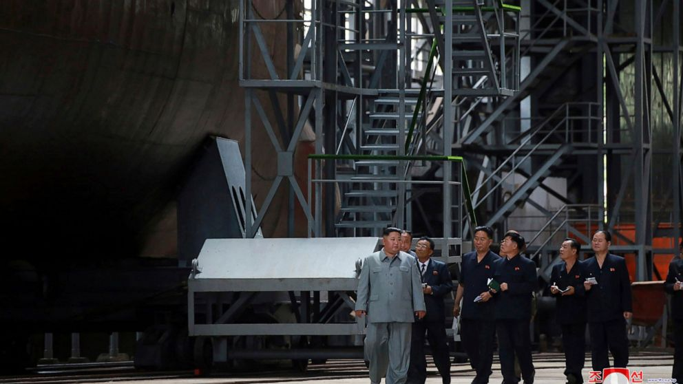 Kim inspects new submarine, wants NKorean military bolstered thumbnail