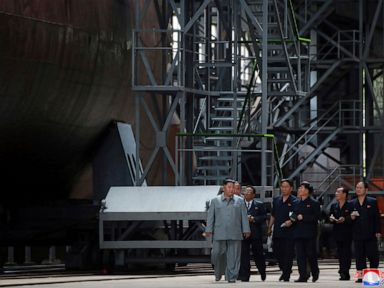 Kim inspects new submarine wants NKorean military bolstered