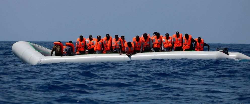 In this photo taken Saturday and released Sunday, Aug. 11, 2019, a rubber dinghy with over 80 migrants off the Libyan coast has received life vests from a rescue team of the Ocean Viking ship, operated by the NGOs Sos Mediterranee and Doctors Without