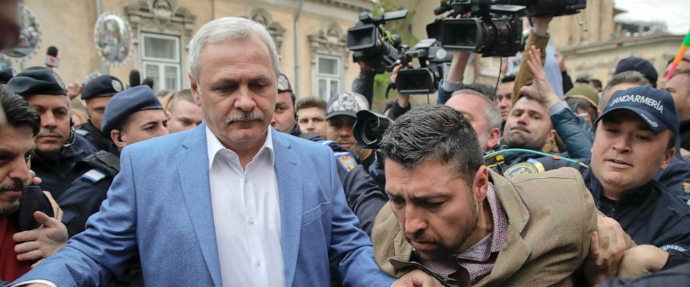Liviu Dragnea, left, the leader of Romanias ruling Social Democratic party, arrives escorted by police officers for court hearing in a trial in Bucharest, Romania, Monday, April 15, 2019. The High Court for Cassation and Justice has postponed a verd