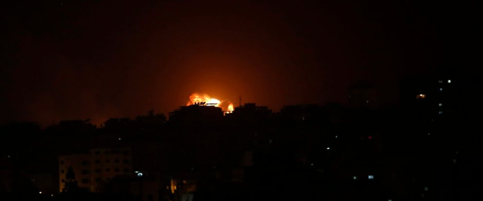 An explosion caused by Israeli airstrikes is seen on Gaza City, early Friday, March 15, 2019. Israeli warplanes attacked militant targets in the southern Gaza Strip early Friday in response to a rare rocket attack on the Israeli city of Tel Aviv, as