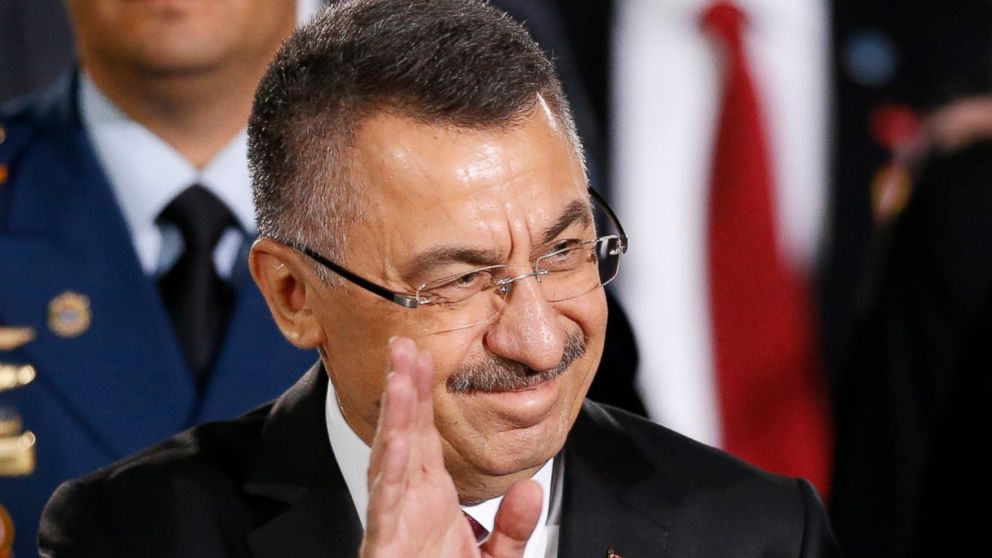 Turkey's Vice President Fuat Oktay waves upon arrival to the Supreme Court for the inauguration ceremony of Venezuelan President Nicolas Maduro in Caracas, Venezuela, Thursday, Jan. 10, 2019. Maduro will be sworn in to a second term amid international calls for him to step down and a devastating economic crisis, but with some long-time friends in attendance both from abroad and at home. (AP Photo/Ariana Cubillos)