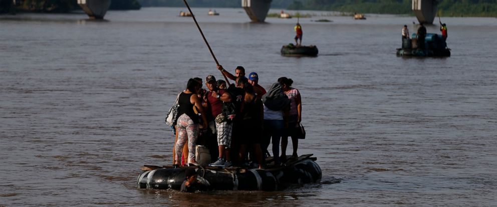 Migrants cross by raft from Tecun Uman, Guatemala, left, to Ciudad Hidalgo, Mexico, on Friday, June 14, 2019. Raftsmen and riverfront business operators said the flow of migrants through the crossing has decreased noticeably since the announcement a