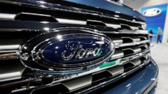 FILE - In this file photo dated Thursday, March 28, 2019, the Ford Motor company logo at the auto show in Denver, USA. Carmaker Ford said Thursday June 27, 2019, it is shedding 12,000 jobs in Europe as it streamlines operations in the region to incre