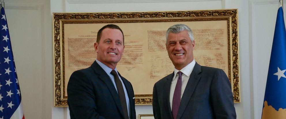 Kosovos president Hashim Thaci, right, shakes hands with President Donald Trumps envoy for the Kosovo-Serbia dialogue, Ambassador Richard Grenell in Kosovo capital Pristina on Wednesday, Oct. 9, 2019. (AP Photo/Visar Kryeziu)