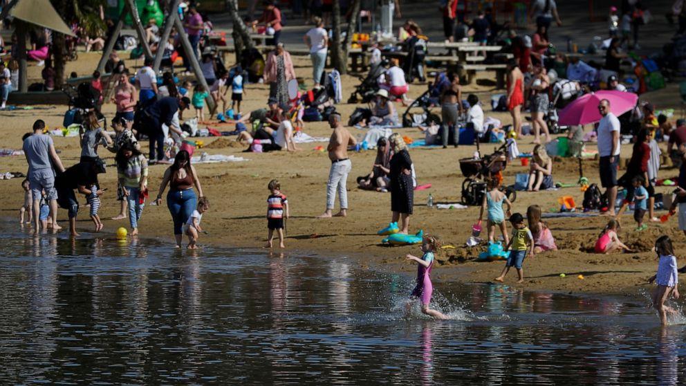 Belgians breach virus rules as warm weather draws crowds