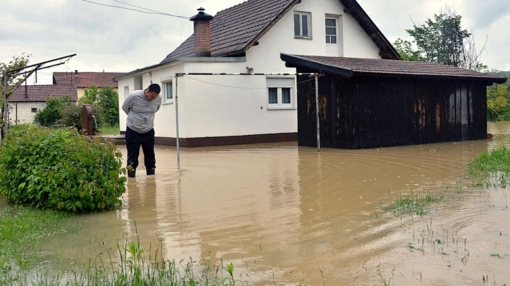 Floods renew fear in Bosnia; boy missing after fall in creek