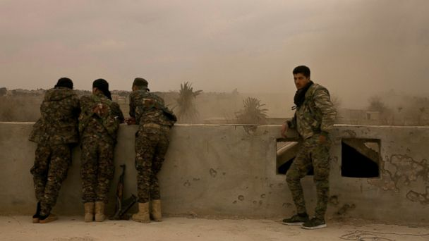 IS militants, families surrender after offensive in Syria