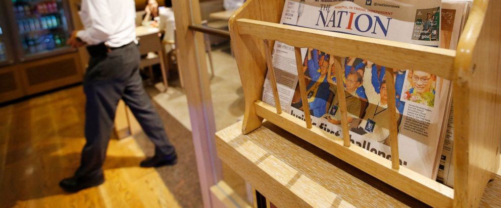 Thailands English newspaper The Nation is displayed in a cafe in a hotel in Bangkok, Thailand, Thursday, May 16, 2019. The management of The Nation - founded in 1971 and one of Thailands two English language dailies _ said that due to falling reven